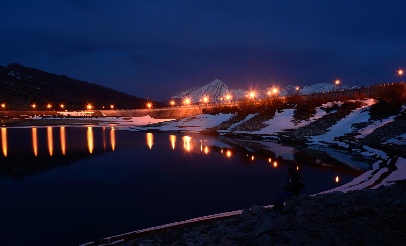 Hydroelectric power plant illuminated at night